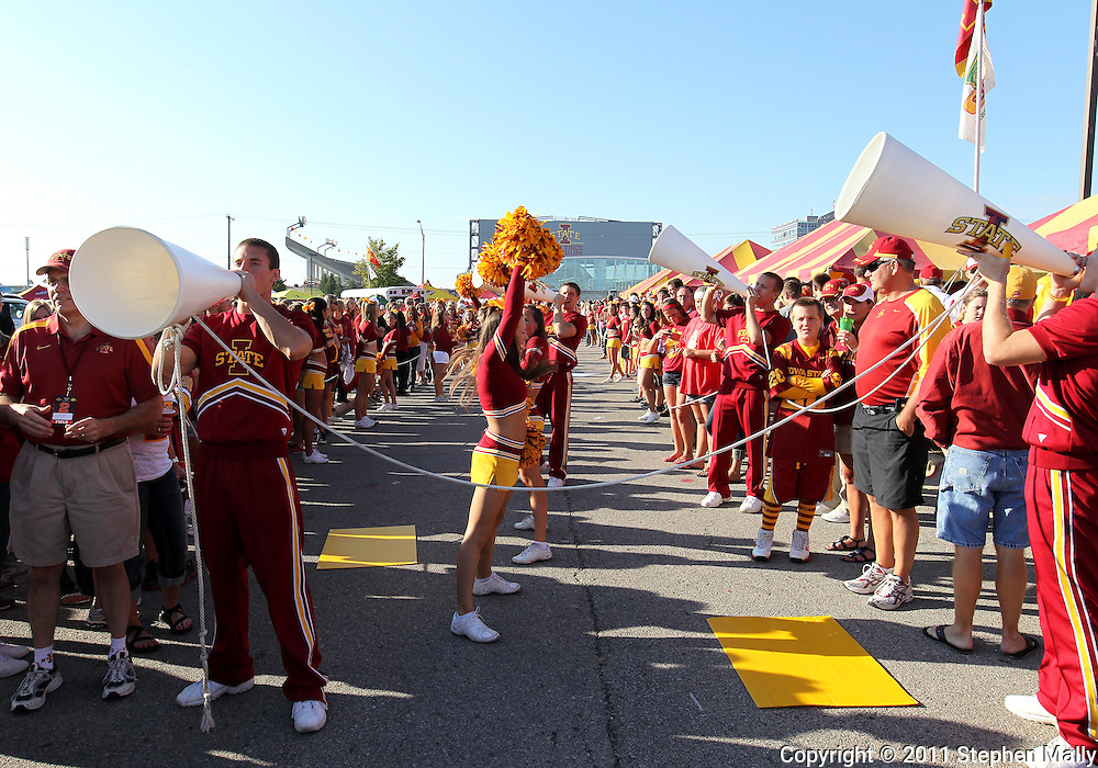 September 10, 2011: Iowa State cheerleaders pump up the crowd as they wait for the team to arrive before the game between the Iowa Hawkeyes and the Iowa State Cyclones during the Iowa Corn Growers Cy-Hawk game at Jack Trice Stadium in Ames, Iowa on Saturday, September 10, 2011.