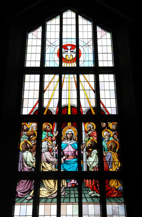 Stained glass image from St. William Church, Waukesha, Wis., depicts Holy Spirit descending upon the apostles at Pentecost. (Photo by Sam Lucero)