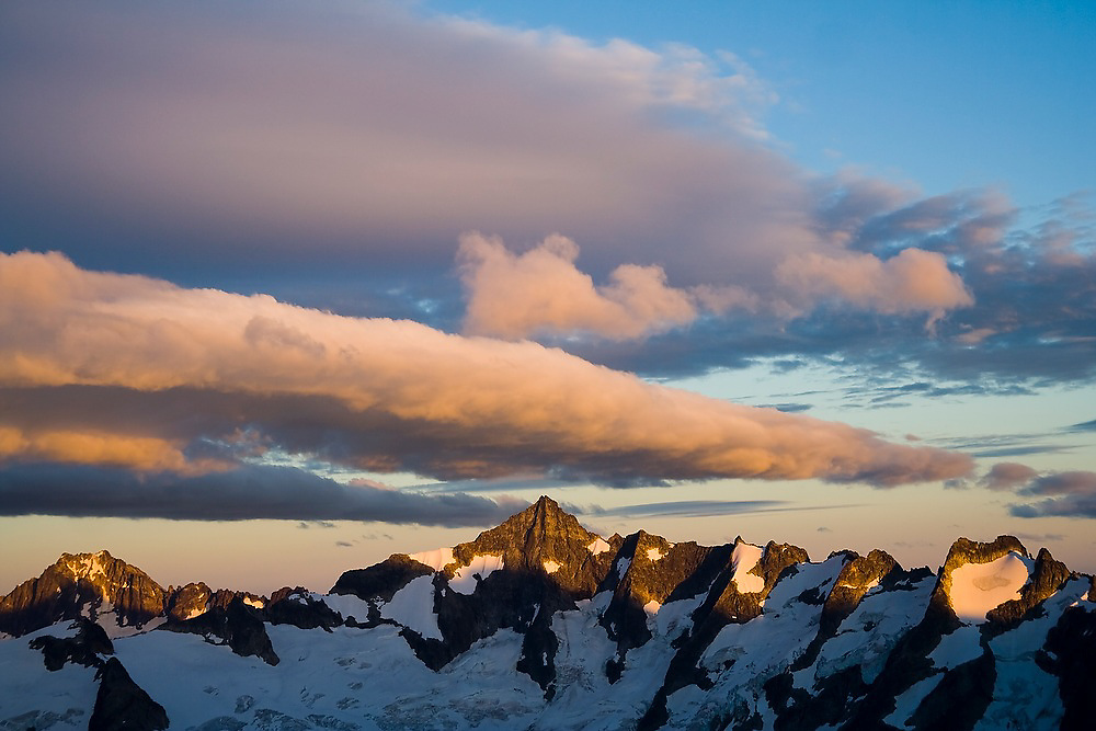 Forbidden Peak seen from Klawatti Col, with dramatic clouds at sunset, North Cascades National Park, Washington.