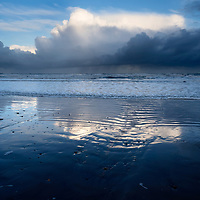 Clouds Reflected in Wet Sand on the Beach at Cayton Bay near Scarborough North Yorkshire England
