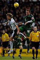 Photo: Glyn Thomas.<br />Derby County v Norwich City. Coca Cola Championship.<br />03/12/2005.<br />Norwich's Dean Ashton (R) battles for the ball in mid-air with Derby's Inigo Idiakez.