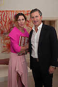 VALERIA NAPOLEONE; WITH HER HUSBAND GREGORIO, Valeria Napoleone hosts a dinner at her apartment e to celebrate the publication of her book  Valeria Napoleone's Catalogue of Exquisite Recipes. Palace Green. Kensington. London. 28 September 2012.