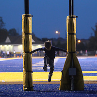 Adam Robison | BUY AT PHOTOS.DJOURNAL.COM<br /> Aaron Campbell, 5, of Tupelo, leaps through the posts of the 25 second play clock prior to kickoff of the Tupelo game against South Panola Friday night.