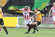 Nigel Atangana and Gary Deegan  during the EFL Sky Bet League 2 match between Cambridge United and Cheltenham Town at the Cambs Glass Stadium, Cambridge, England on 25 August 2018.