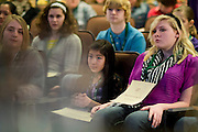 Participants watch another student spell a word during the Southeast Ohio Regional Spelling Bee Saturday, March 16, 2013. The Regional Spelling Bee was sponsored by Ohio University's Scripps College of Communication and held in Margaret M. Walter Hall on OU's main campus.