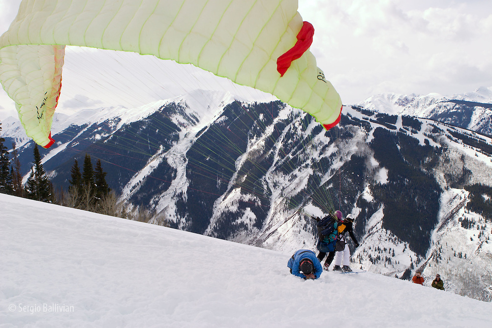 Paragliders take off from Ajax mountain during winter in Aspen, Colorado.