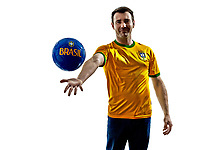 one man with Brazilian jersey throwing giving soccer ball isolated in white background