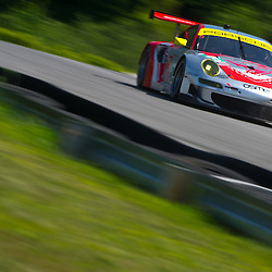 July 6, 2012 - The Flying Lizard Motorsport Porsche 911 GT3 RSR driven by Patrick Long and Jörg Bergmeister during the American Le Mans Northeast Grand Prix weekend at Lime Rock Park in Lakeville, Conn.