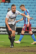 Tom Pope (11) of Bury picks himself up after scoring goal during the Sky Bet League 1 match between Scunthorpe United and Bury at Glanford Park, Scunthorpe, England on 19 April 2016. Photo by Ian Lyall.
