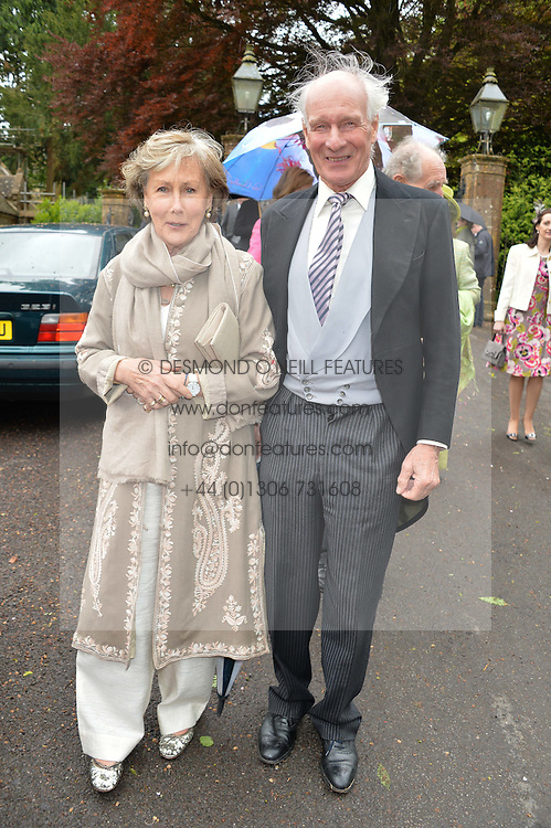 CHARLES & PATTI PALMER-TOMKINSON at the wedding of Princess Florence von Preussen second daughter of Prince Nicholas von Preussen to the Hon.James Tollemache youngest son of the 5th Lord Tollemache held at the Church of St.Michael & All Angels, East Coker, Somerset on 10th May 2014.