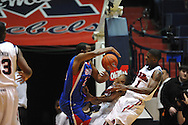 """SMU's Robert Nyakundi (24) crashes into Ole Miss' Dundrecous Nelson (5) and Ole Miss' Terrance Henry (1) at the C.M. """"Tad"""" Smith Coliseum in Oxford, Miss. on Tuesday, January 3, 2012."""