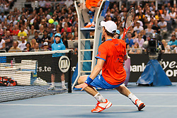 © Licensed to London News Pictures. 21/01/2012. Melbourne Park, Australia. Andy Murray (GBR) crouches at the net to play the ball in his men's singles match against Michael Llodra (FRA) during the 6th day, round 3 of the Australian Open. Photo credit : Asanka Brendon Ratnayake/LNP