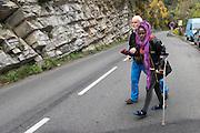 November 9, 2016 - Breil-sur-Roya, France: Sylvain (L) helps Salam, an injured Eritrean migrant who has  arrived through a  tunnel by foot in the Roya valley from Italy - a 7-hour walk. By doing so, Sylvain, a 67-year-old retired school teacher, risks police arrests and a trial. <br /> <br /> 9 novembre 2016 - Breil-sur-Roya, France: Sylvain (L) aide Salam, un migrant érythréen blessé qui est arrivé par un tunnel à pied dans la vallée de la Roya depuis l'Italie - une trajet de 7 heures. En faisant cela, Sylvain, un enseignant à la retraite âgé de 67 ans, risque une arrestation et un procès.