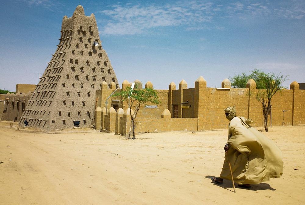 Tuareg man passes by Sankor�osque in Timbuktu, Mali.