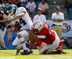11.07.2011, UPC Arena, Graz, AUT, American Football WM 2011, Group B, Frankreich (FRA) vs Japan (JPN), im Bild Jeremy Larroque (France, #24, REC ) beeing stopped by japanese defense// during the American Football World Championship 2011 Group B game, France vs Japan, at UPC Arena, Graz, 2011-07-11, EXPA Pictures © 2011, PhotoCredit: EXPA/ E. Scheriau