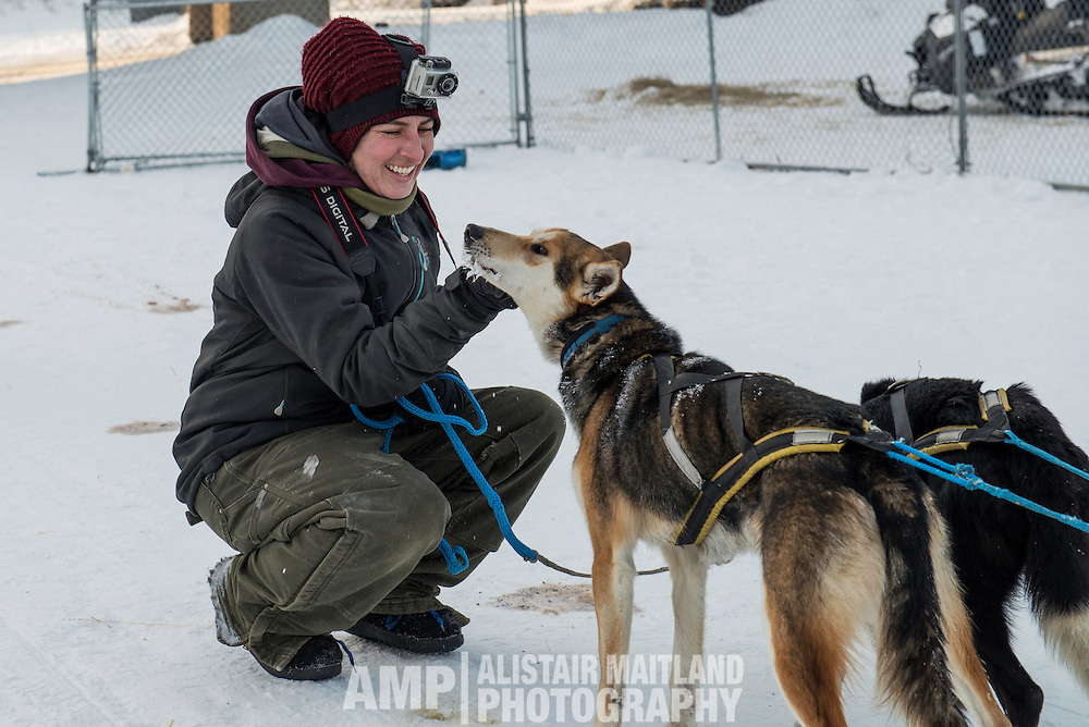 Julie, Denis' partner and handler greeting the lead dogs.
