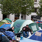 Early Monday morning..Day three of the occupation - and the first Monday. The Occupy London Stock Exchange movement was formed in London in solidarity with the US based Occupy Wall Street. The movements are a respons and in anger to what is seen by many as corporate greed and a failed banking system being bailed out by the public, - which in return are suffering austerity measures to make up for the billions of lost money. The movement occupied the St Paul's Square in the City of London Sat Oct 15 after it failed to secure and occupy Pator Noster Square and the Stock Exchnage itself.