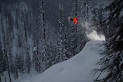 On a three week trip to Revelstoke, BC we spent a lot of time in the trees because it was snowing so much we couldn't see in the alpine! Here pro snowboarder Curtis Ciszek performs late in to the afternoon for the camera and flash in the Eagle Pass backcountry zone West of town.