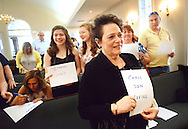 Rosemarie Kaupp holds a paper with her deceased son Chris's name as part of an activity during a butterfly release and memorial at Kirk and Nice Funeral Home Sunday May 8, 2016 in Feasterville, Pennsylvania.  (Photo by William Thomas Cain)