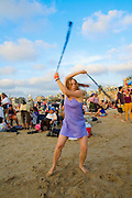 Israel, Tel aviv, Drum beach, female model of 20 dancing with pois