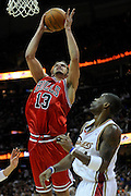 Apr 19, 2010; Cleveland, OH, USA; Chicago Bulls center Joakim Noah (13) shoots over Cleveland Cavaliers forward Antawn Jamison (4) during the third period in game two in the first round of the 2010 NBA playoffs at Quicken Loans Arena. The Cavaliers beat the Bulls 112-102. Mandatory Credit: Jason Miller-US PRESSWIRE