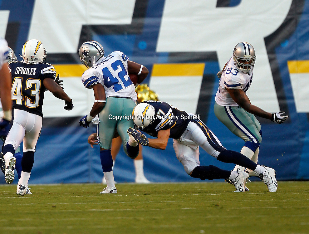 San Diego Chargers quarterback Philip Rivers (17) makes a tackle on Dallas Cowboys safety Barry Church (42) near the Chargers goal line after Church recovers a Chargers fumble during a NFL week 2 preseason football game against the Dallas Cowboys on Saturday, August 21, 2010 in San Diego, California. The Cowboys won the game 16-14. (©Paul Anthony Spinelli)