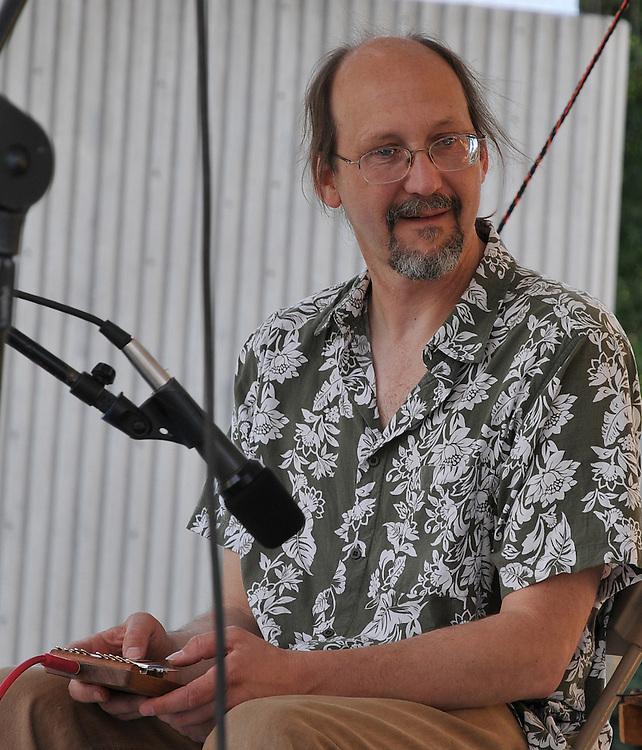 Mark Holdaway plays kalimba during the Martin Klabunde concert at the 2010 Tucson Folk Festival.