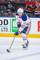 PENTICTON, CANADA - SEPTEMBER 16: Caleb Jones #81 of Edmonton Oilers skates with the puck against the Vancouver Canucks on September 16, 2016 at the South Okanagan Event Centre in Penticton, British Columbia, Canada.  (Photo by Marissa Baecker/Shoot the Breeze)  *** Local Caption *** Caleb Jones;