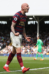 Newcastle United's Jonjo Shelvey celebrates scoring his side's opening goal during the Premier League match at Craven Cottage, London.
