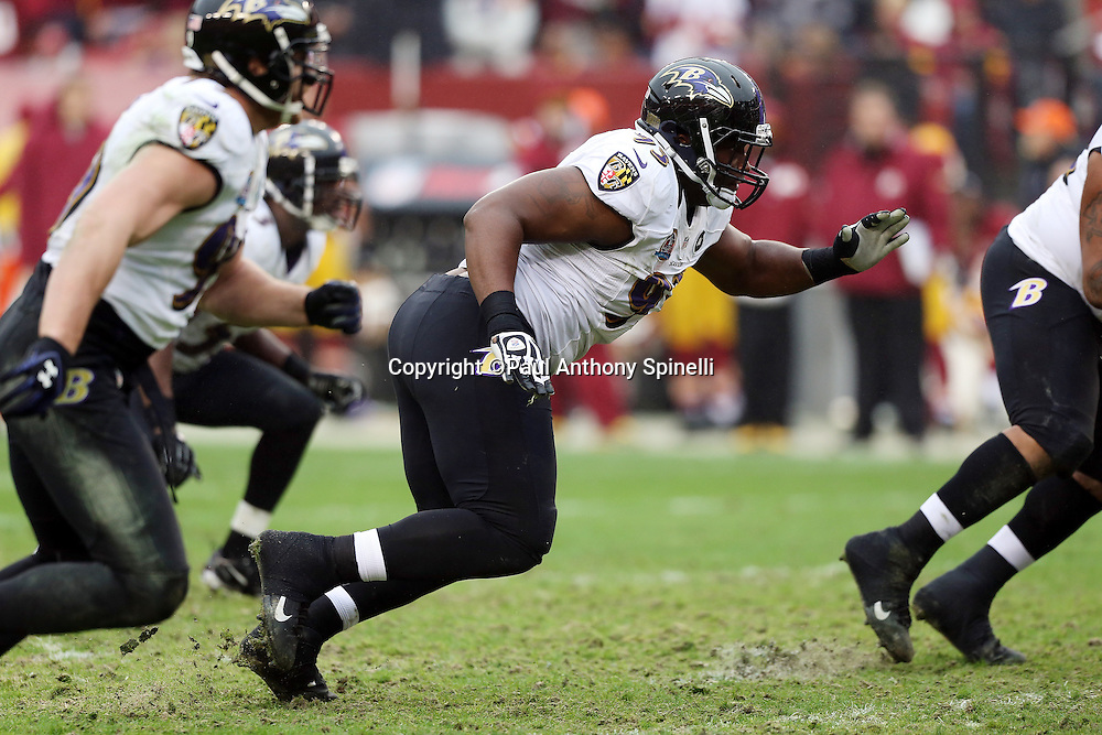 Baltimore Ravens defensive end DeAngelo Tyson (93) rushes during the NFL week 14 football game against the Washington Redskins on Sunday, Dec. 9, 2012 in Landover, Md. The Redskins won the game in overtime 31-28. ©Paul Anthony Spinelli