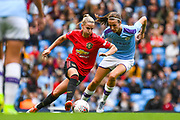 Manchester United Women midfielder Jackie Groenen (14) and Manchester City Women midfielder Jill Scott (8) in action during the FA Women's Super League match between Manchester City Women and Manchester United Women at the Sport City Academy Stadium, Manchester, United Kingdom on 7 September 2019.