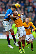 Connor Goldson (#6) of Rangers FC and Curtis Main (#9) of Motherwell FC challenge for a header during the Ladbrokes Scottish Premiership match between Motherwell and Rangers at Fir Park, Motherwell, Scotland on 26 August 2018.