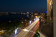 A stream of traffic next to the Saigon River from the Majestic Hotel at dusk in Ho Chi MInh City, Vietnam, Southeast Asia