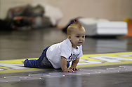 "NOTTINGHAM, ENGLAND, SEPTEMBER 26, 2012: A young Dan Hardy fan cralws on the mat during the open work-out sessions ahead of ""UFC on Fuel TV 5: Struve vs. Miocic"" inside Gym Combat in Nottingham, United Kingdom on Wednesday, September 26, 2012 © Martin McNeil"
