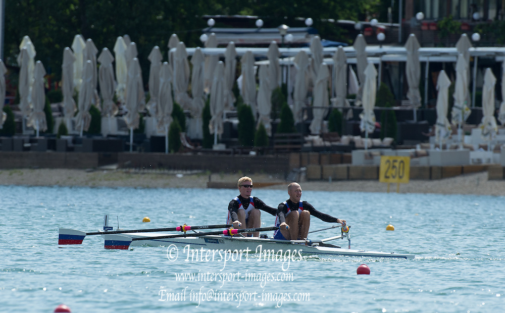 Belgrade, SERBIA,  RUS LM2X, Bow Mikhail UFIMTCEV and Ivan KUDRYAVSEV at the start of their heat at the 2014 FISA European Rowing Championships. Lake Sava. <br /> <br /> <br /> 10:15:18  Friday  30/05/2014<br /> <br /> [Mandatory Credit; Peter Spurrier/Intersport-images]