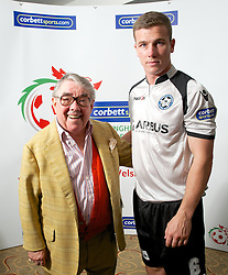CARDIFF, WALES - Tuesday, August 14, 2012: Airbus UK's Tom Field with Ronnie Corbett, the sporting ambassador ot Corbett Sport, at the launch the 2012/2013 Welsh Premier League at the St. David's Hotel. (Pic by David Rawcliffe/Propaganda)