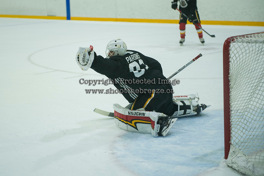 PENTICTON, CANADA - SEPTEMBER 8: Tyler Parsons #82 of Calgary Flames makes a save during  morning practice on September 8, 2017 at the South Okanagan Event Centre in Penticton, British Columbia, Canada.  (Photo by Marissa Baecker/Shoot the Breeze)  *** Local Caption ***