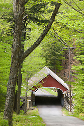 The Flume Covered Bridge spans the Pemigewasset River in Franconia Notch State Park in New Hampshire's White Mountains.