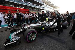 Mercedes' Lewis Hamilton is led to the starting grid during the Abu Dhabi Grand Prix at the Yas Marina Circuit, Abu Dhabi.