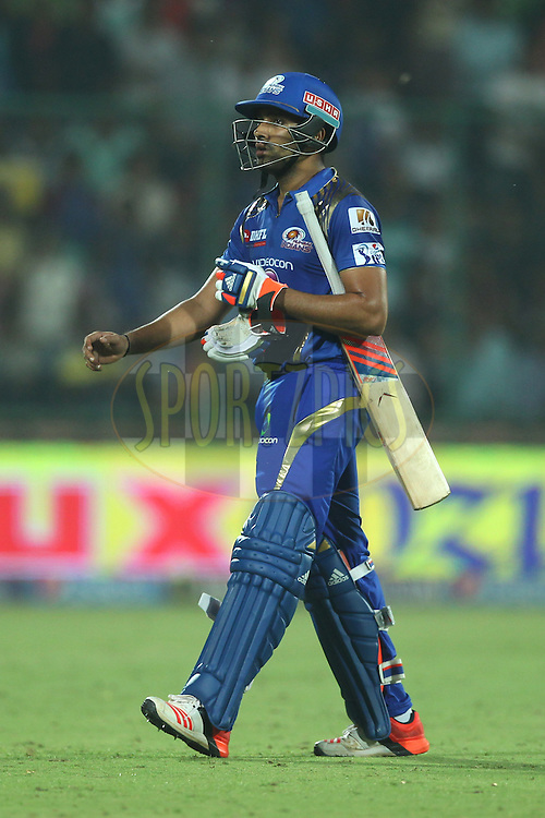 Rohit Sharma captain of the Mumbai Indians walk back during match 21 of the Pepsi IPL 2015 (Indian Premier League) between The Delhi Daredevils and The Mumbai Indians held at the Ferozeshah Kotla stadium in Delhi, India on the 23rd April 2015.<br /> <br /> Photo by:  Deepak Malik / SPORTZPICS / IPL
