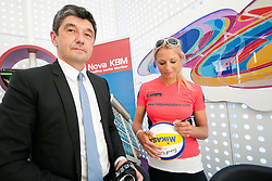 Aleksander Batic, executive director of the Nova KBM, and Erika Fabjan at Fabjan Sisters Press Conference about signing sponsorship contract with Nova Kreditna Banka Maribor, on May 24, 2011 in NKBM Poslovalnica Ljubljana, , Slovenia. (Photo by Matic Klansek Velej / Sportida)