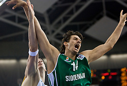 Ksistof Lavrinovic of Lithuania and Jurica Golemac (14) of Slovenia during the EuroBasket 2009 Group F match between Slovenia and Lithuania, on September 12, 2009 in Arena Lodz, Hala Sportowa, Lodz, Poland.  (Photo by Vid Ponikvar / Sportida)