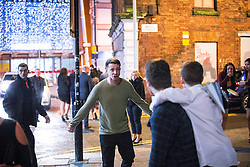 © Licensed to London News Pictures . 01/01/2016 . Manchester , UK . A man with his fists clenched in a fight . Revellers in Manchester on a New Year night out at the clubs around the city centre's Printworks venue . Photo credit : Joel Goodman/LNP