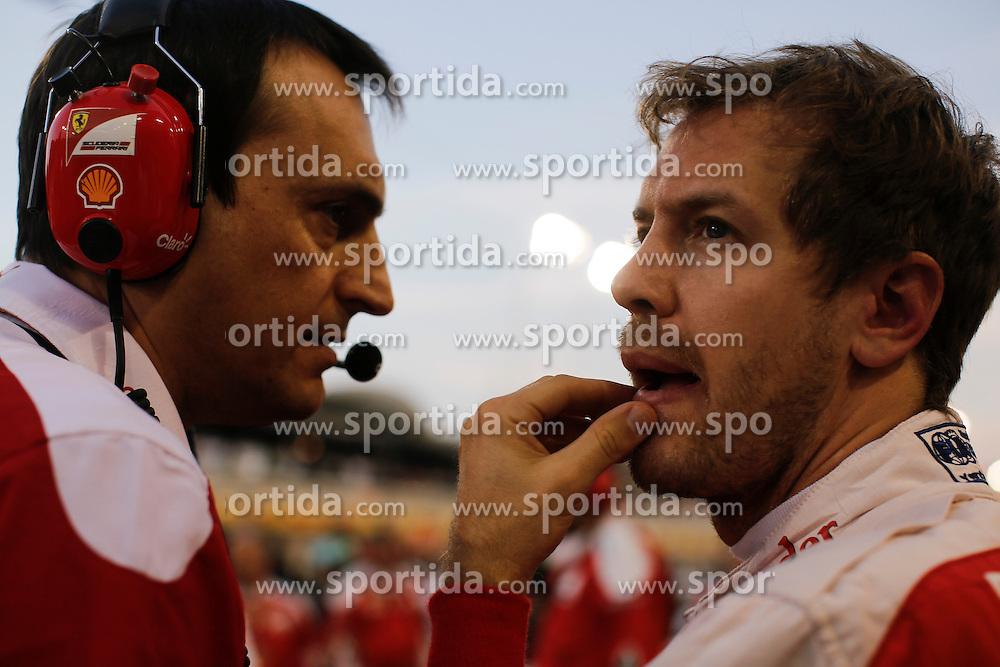 03.04.2016, International Circuit, Sakhir, BHR, FIA, Formel 1, Grand Prix von Bahrain, Rennen, im Bild Sebastian Vettel (GER) Ferrari and Riccardo Adami (ITA) Ferrari Engineer // during Race for the FIA Formula One Grand Prix of Bahrain at the International Circuit in Sakhir, Bahrain on 2016/04/03. EXPA Pictures &copy; 2016, PhotoCredit: EXPA/ Sutton Images/ Gasperotti/<br /> <br /> *****ATTENTION - for AUT, SLO, CRO, SRB, BIH, MAZ only*****