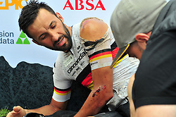 PAARL SOUTH AFRICA - MARCH 23: Manuel Fumic being tended to after a crash he had during the 70km final day, stage 7 on March 23, 2018 Wellingtion to Paarl, South Africa. Mountain bikers gather from around the world to compete in the 2018 ABSA Cape Epic, racing 8 days and 658km across the Western Cape with an accumulated 13 530m of climbing ascent, often referred to as the 'untamed race' the Cape Epic is said to be the toughest mountain bike event in the world. (Photo by Dino Lloyd)