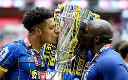 Lyle Taylor of AFC Wimbledon and Adebayo Akinfenwa of AFC Wimbledon kiss The League Two Playoff Final Trophy - Mandatory by-line: Robbie Stephenson/JMP - 30/05/2016 - FOOTBALL - Wembley Stadium - London, England - AFC Wimbledon v Plymouth Argyle - Sky Bet League Two Play-off Final