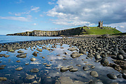 UNITED KINGDOM, Northumberland: 16 July 2017 The remains of Dunstanburgh Castle stand on the headland near Craster, Northumberland. Dunstanburgh castle was built in the 14th century during the hostilities between King Edward II and Earl Thomas of Lancaster, and was the site of fierce fighting during The War of the Roses.  Rick Findler / Story Picture Agency