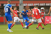 Brad Inman is challenged as he shoots during the EFL Sky Bet League 1 match between Fleetwood Town and Rochdale at the Highbury Stadium, Fleetwood, England on 18 August 2018.