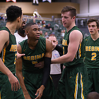 5th year forward Travis Sylvestre (7) of the Regina Cougars helps his teammate 4th year guard Brandon Tull (5) to his feet after a tumble in the paint during the home game on November  5 at Centre for Kinesiology, Health and Sport. Credit: /Arthur Images