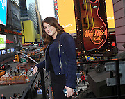 "Meghan Trainor poses on the marquee at Hard Rock Cafe New York, Monday, May 9, 2016, in Times Square, to reveal the music video for her new single, ""Me Too,"" from her second album Thank You. (Photo by Diane Bondareff/Invision for Hard Rock International/AP Images)"